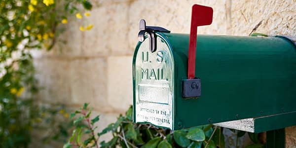 US post mail letter box with red flag